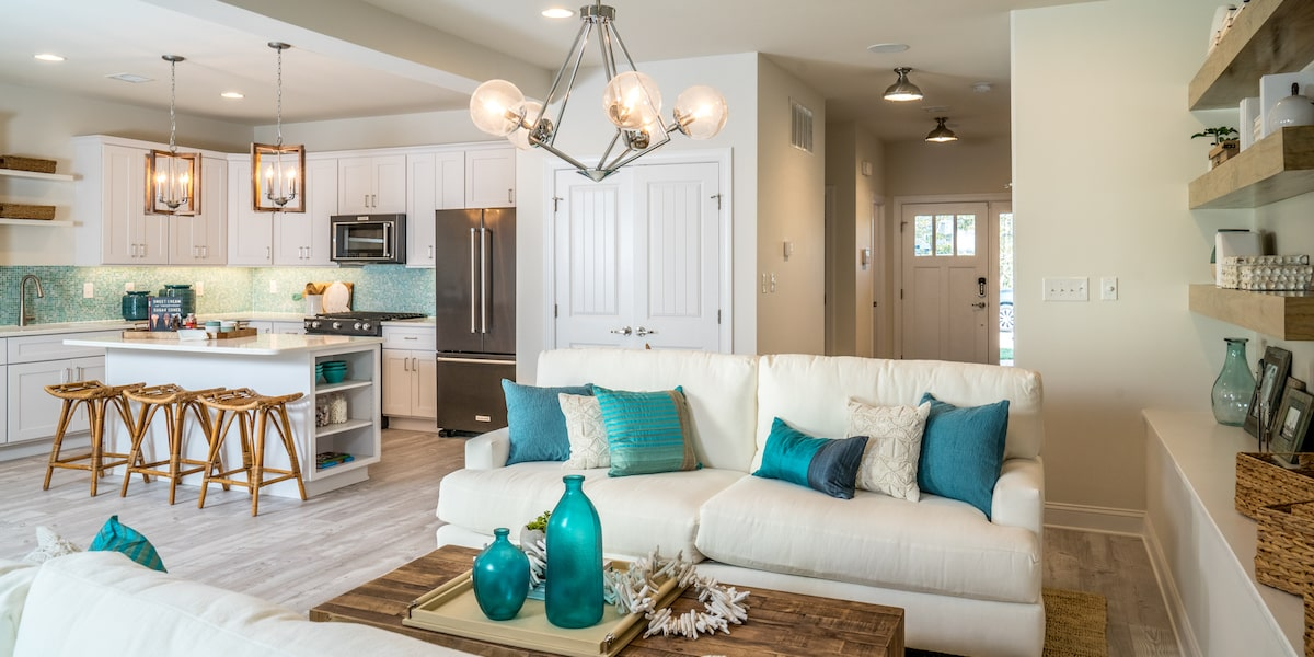 Gathering area and kitchen from a new home inside Friendship Creek.